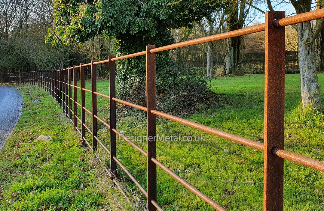 Estate fencing installation with rust finish.