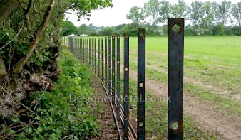 Fencing posts set up ready to take the bar then be welded on-site