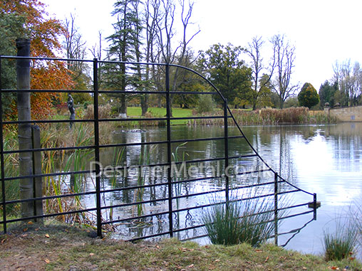Deer fencing beside water.