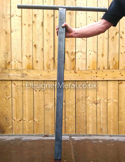 Post straightner for adjusting posts in the ground.