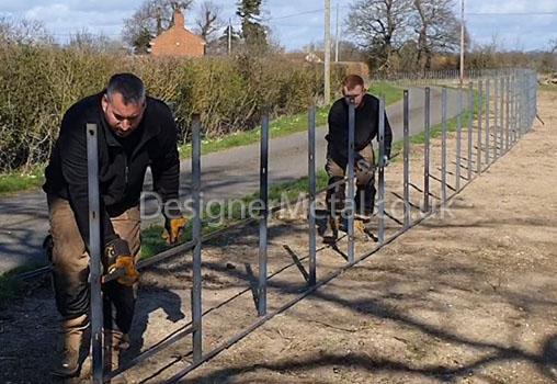 Rodding-up estate fencing posts.