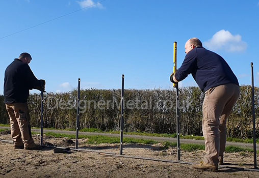 Setting out estate fencing posts.