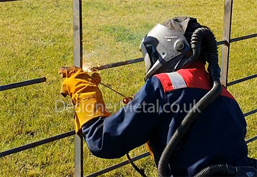 Welding the post and rail on estate fencing posts