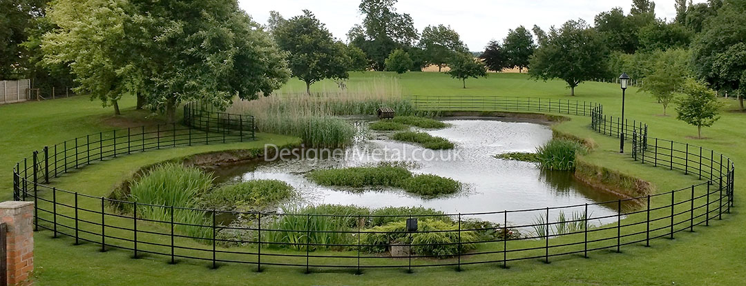 Installation of estate fencing around a large pond