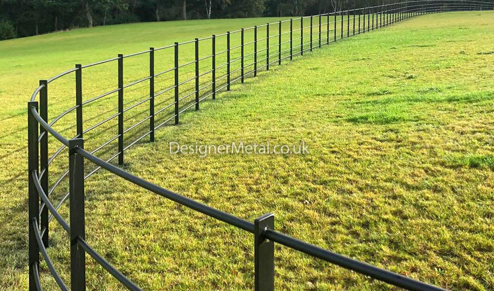 Style 1 estate fencing installed on a hillside.