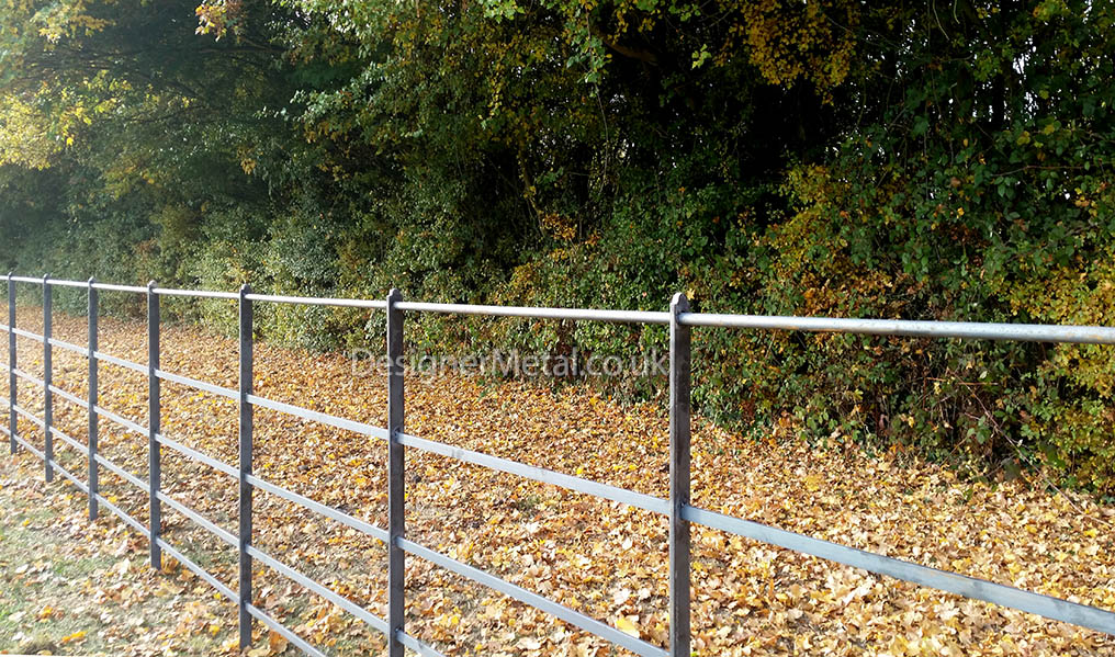 Style F4 estate fencing with feature top post detail.